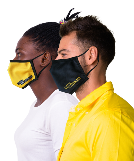 Side profile of a black woman and white man wearing cystic fibrosis trust facemasks