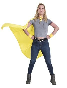 Girl was blonde hair standing with hands on hips wearing grey t-shirt and jeans wearing yellow superhero cape
