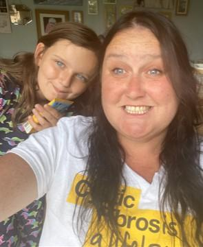 Selfie of mum with daughter. Mum is wearing a Cystic Fibrosis Trust t-shirt